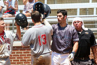 007 - Dalton's JP Tighe is congratulated at home plate after hitting a two-run homer